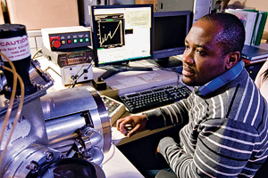 Eric Osei-Yiadom in the XPS/Auger microscopy lab at Discovery Park. (Photo by Jonathan Reynolds)
