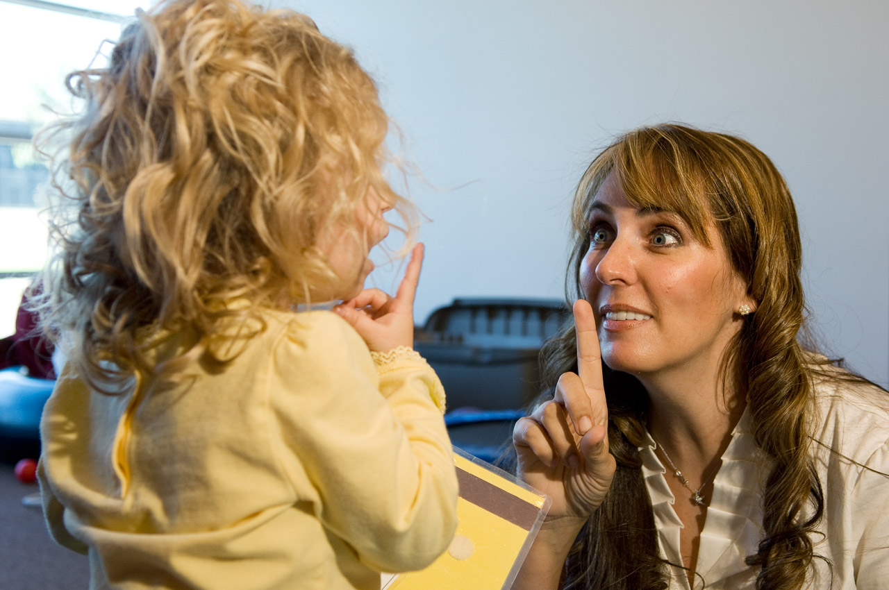 Kristin Farmer working with a child (Photo by Michael Clements)