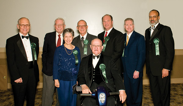 "From left: William ""Bill"" Lively ('70 M.M.Ed.), Paul Voertman, Mickey and Bill McCarter, Charles W. Nelson ('50, '51 M.M.Ed.),  Jordan Case ('81), G. Brint Ryan ('88, '88 M.S.) and Charles O'Neal."
