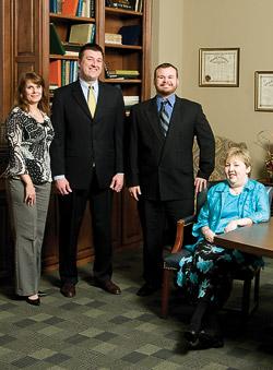 UNT Alumni Association staff members (from left): Lynetta Neilson, Derrik P. Morgan, Rob McKinney and Lorie Ingram. (Photo by Mike Woodruff)