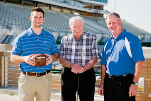 From left, Sean January, Don January ('53) and Tim January ('79) near the new UNT Mean Green Stadium. (Photo by Michael Clements)