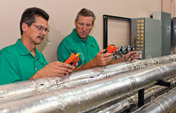 Solar Logic recently entered the incubator program at UNT's Discovery Park. Pictured are Greg Bohl, president and CEO, left, and Drew Springer ('88), chief operating officer, right. (Michael Clements)