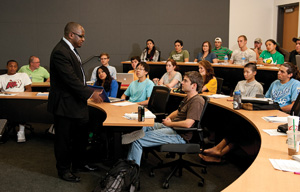 Robert Hinson, professor of marketing from the University of Ghana, lectures to a UNT marketing class in September in UNT's new Business Leadership Building. (Photo by Jonathan Reynolds)