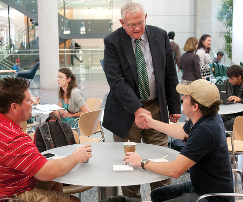 President V. Lane Rawlins visits with students and welcomes them back for the Fall semester. (Photo by Jonathan Reynolds)