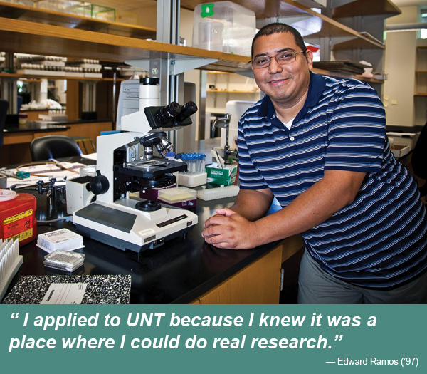 Postdoctoral fellow Edward Ramos ('97), in his genetics lab at the Rollins Research Center at Emory University, studies chromosome organization to better understand cancer cells. (Bryan Meltz/Emory University)