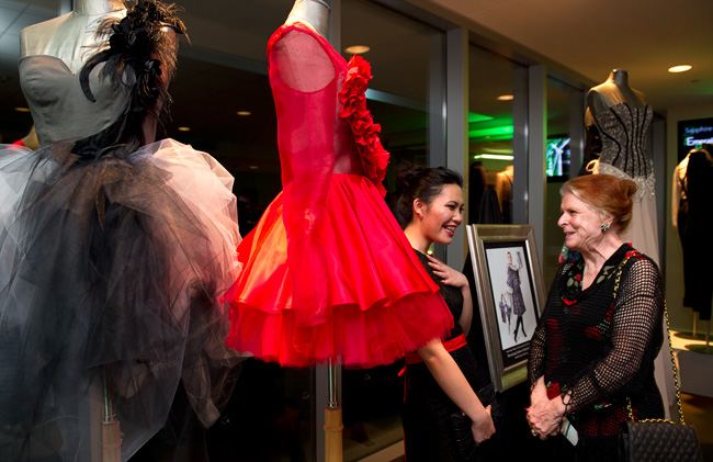 Fashion design major and Emerald Eagle Scholar Kim Pham, visiting with guest Anna Ricco, displayed her work at the ball. (Photo by Gary Payne)