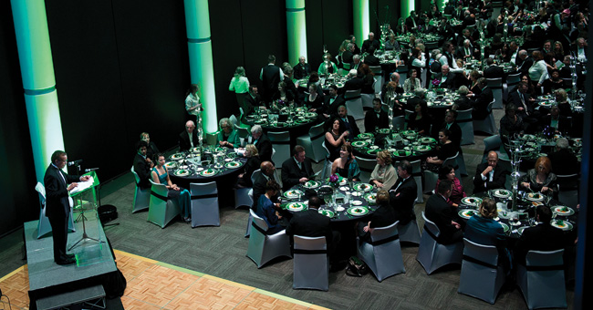 Guests at the 2012 Emerald Ball Feb. 25 filled the Club Level of UNT's Apogee Stadium, where journalist Bob Ray Sanders ('69) served as emcee. The ball attracted about 400 guests, the largest crowd in its six-year history, and raised about $400,000, which includes donations, sponsorships and matching funds, for the Emerald Eagle Scholars program. The program helps academically talented students with high financial need attend college. (Photo by Gary Payne)