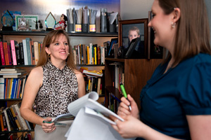 Art professor Kelly Donahue-Wallace and former student Julie Thompson talk about grant writing. (Photo by Gary Payne)