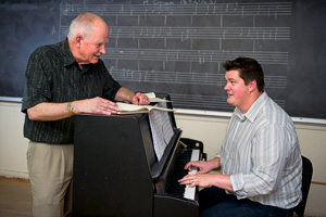 Music professor Graham Phipps and doctoral student Ben Dobbs ('10 M.M.)  (Photo by Gary Payne)