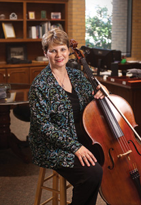 Freelance cellist for the Fort Worth and Dallas symphonies, Debbie Brooks ('77, '81 M.M.), also organizes orchestras for big-name performers across the state and nation. (Photo by Angilee Wilkerson)
