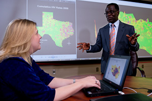 Geography professor Joseph Oppong and Ph.D. student Jody Huddleston ('10) (Photo by Gary Payne)