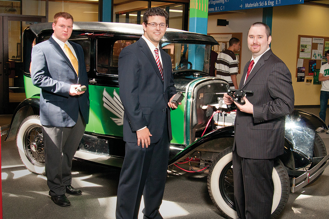 Matt Kidd, Brent Elliot, and Jeff Smith with the electric modified Ford Model A. (Photo by Jonathan Reynolds)