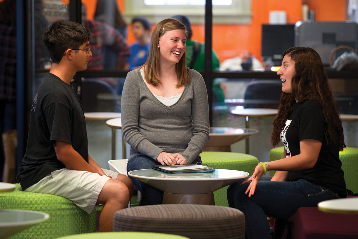 Ashley Hinck, a junior psychology major, middle, was an undecided major as a freshman, but after a First-Year Seminar class, she discovered her passion for counseling. Now she mentors freshmen Paul Barrera, left, and Lexi Montoya, right. (Photo by Gary Payne)