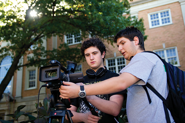 Matthew Beldon, a sophomore radio/TV/film major, right, lives in a REAL community in Kerr Hall with other RTVF majors, like freshman Wynn Smith, left. They are part of a group producing videos advising freshmen about campus life. (Photo by Gary Payne)