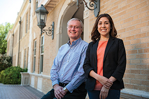 Robert Bland, professor and chair of public administration, with mentee Chelsea Gonzalez ('13 M.P.A.), recent public administration graduate. (Photo by Jonathan Reynolds)