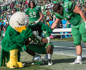 Scrappy consoles a player after a tough loss at the 2016 Heart of Dallas Bowl (Photo by Ahna Hubnik)