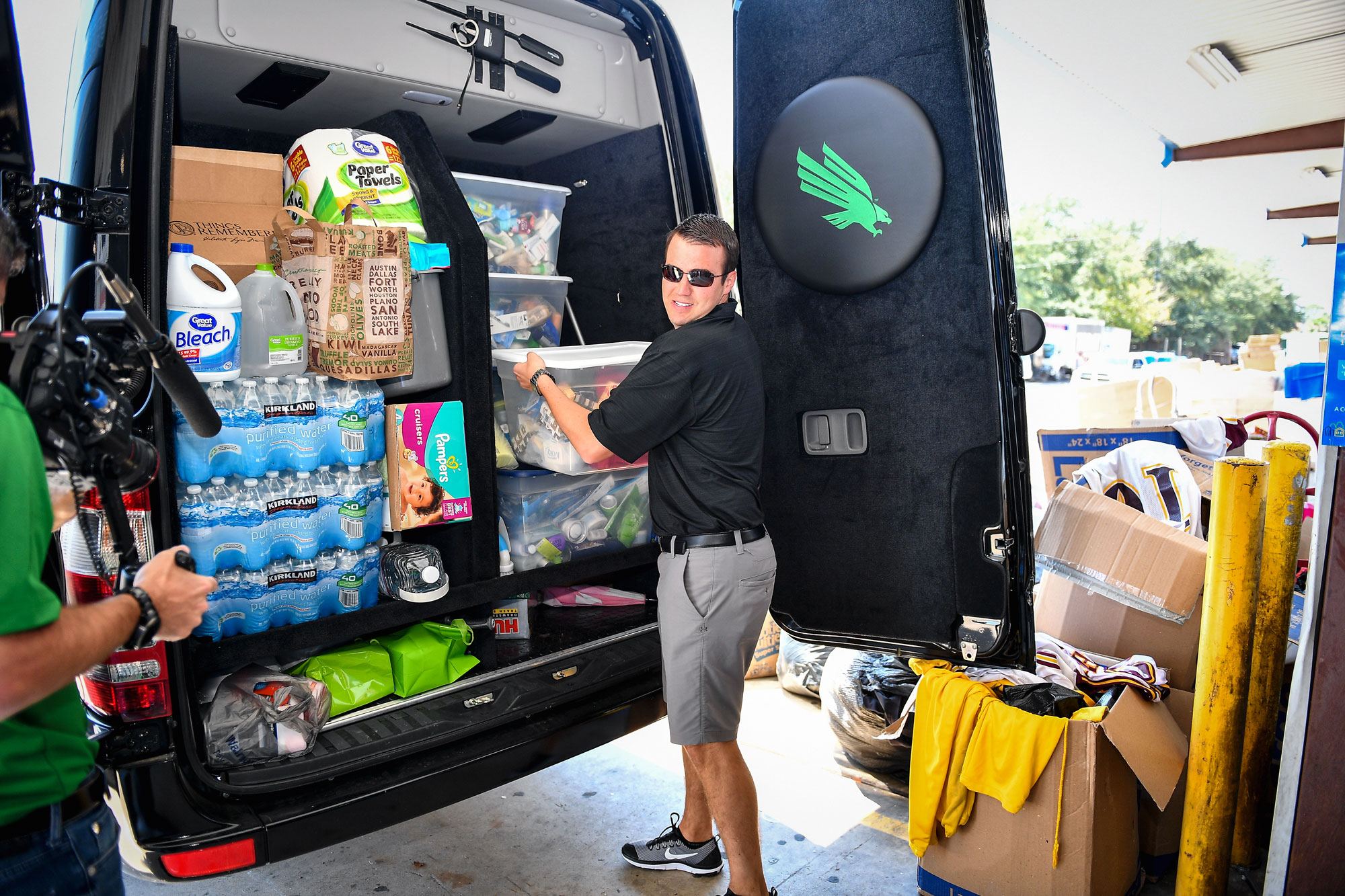 Pictured is Ryan L Peck, Executive Senior Associate Athletic Director for External Affairs, who is delivering supplies for those affected by Hurricane Harvey.