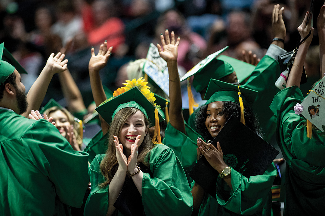 Graduates celebrate in the UNT Coliseum after receiving their degrees. More than 4,800 UNT students graduated in May, ready to achieve their dreams. (Photo by Ahna Hubnik).