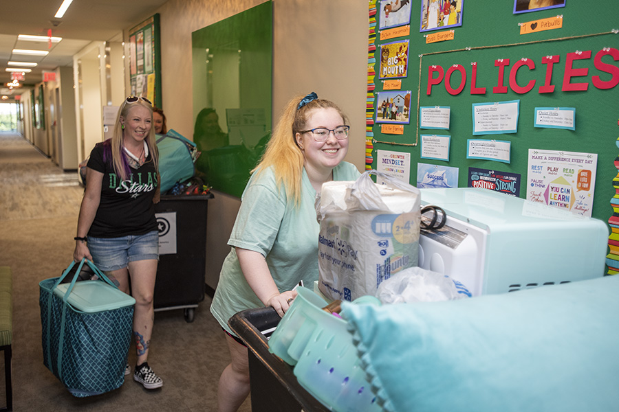 Students moving into Joe Greene Hall, UNT's newestresidence hall, this fall.