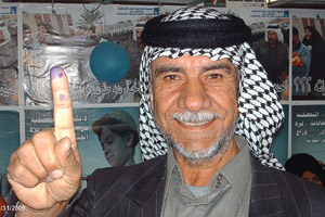A man, above, in Muthanna province in Iraq, voted in the provincial elections last year. All voters dip their fingers in indelible purple ink.