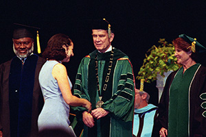 Hurley congratulates a student at Commencement. (Photo by Angilee Wilkerson)