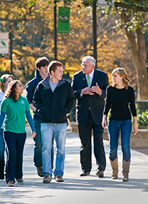 President V. Lane Rawlins visits with students on campus. (Photo by Jonathan Reynolds)
