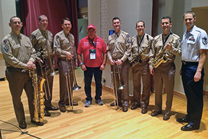 Pictured from left are Master Sgt. Doug Morgan ('96), baritone saxophone; Technical Sgt. Ben Polk ('08), bass trombone; Master Sgt. Ben Patterson ('96), lead trombone; Rheault; Master Sgt. Jeff Martin, trombone; Master Sgt. Andy Axelrad, alto sax; Master Sergeant (select) Tyler Kuebler ('95, '97 M.M.), alto sax and music director; and Master Sgt. Blake Arrington ('02, '04 M.M.), clarinet with concert band and Honor Flight Liaison for the group's visit with the U.S. Air Force band.