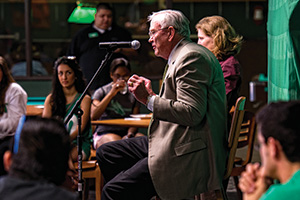 Rawlins speaks with students on campus. (Photo by Michael Clements)