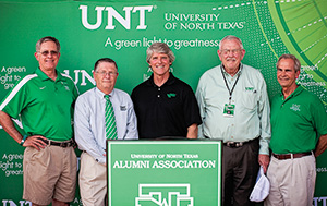 From left, Ben Joyner ('74), Mark Miller ('80), Michael Monticino, President V. Lane Rawlins, UNT System Chancellor Lee Jackson. (Photo by FW Creations)