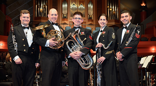 From left, Senior Chief Musician Jim Logan, clarinet; Musician First Class Jason Ayoub, principal horn; Musician First Class Philip Eberly, euphonium; Chief Musician Cynthia Wolverton, bass clarinet; and Musician First Class Joshua Arvizu, oboe, are UNT alumni who are happy to perform with the U.S. Navy Band, one of several elite military bands that count roughly 100 College of Music alumni as members. (Photo by Michael Clements)