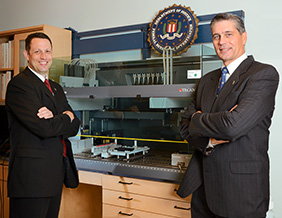"From left, Douglas Hares ('91, '98 Ph.D.) and John E.B. ""JEB"" Stewart ('88 M.S., '96 Ph.D.). (Courtesy of the FBI)"
