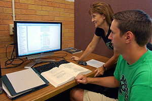 Justin Martin, a UNT student, and Margie Tieslau, associate professor of economics, are on a team of people collaborating with Our Daily Bread to design a statistical model that can better forecast how many meals the community soup kitchen will need to prepare each day.