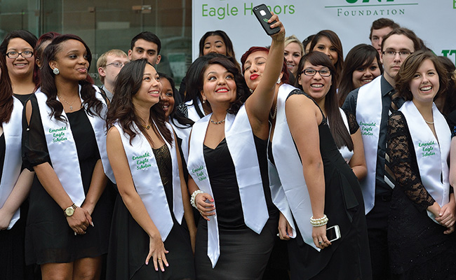 Emerald Eagle Scholars take a selfie while enjoying the event. (Photo by Michael Clements)
