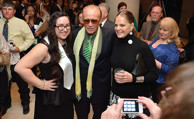 Junior Emerald Eagle Scholar Giselle Garcia with 2014 alumni honoree Peter Weller ('70), and presenter and actress Ali MacGraw. (Photo by Michael Clements)