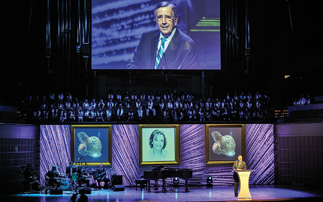 Sportscaster and announcer Brent Musburger presents an alumni award to Phyllis George during the 2014 Emerald Eagle Honors event held at the Morton H. Meyerson Symphony Center in Dallas. (Photo by Michael Clements)