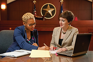 From left, applied arts and sciences senior Joy Nnama job shadows with Denton Country Assistant District Attorney Lara Tomlin ('07) (Photo by Jonathan Reynolds)