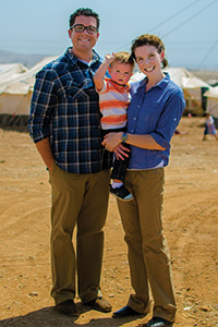Sarah Nowery ('05, '07 M.P.A.) with her family at a refugee camp in northern Iraq.