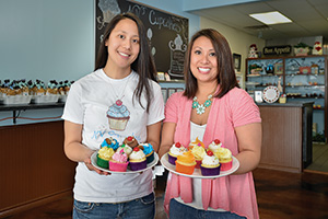 NV Cupcakes - Sisters Van Weaver ('05) and Ngoc Nguyen ('10) build Denton area business baking specialty cakes.(Photo by Michael Clements)