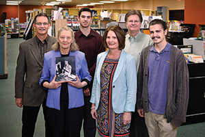 Pender's Music Co. & Music 1st - From left, Richard Gore ('80), Betty Gore, Steven Gore ('10), Becky Wenzel Gore ('81), Ray Gore ('82, '83 M.B.A.) and David Gore carry on the family music business founded by patriarch Harold Gore in Denton, Southlake and Frisco. (Photo by Michael Clements)