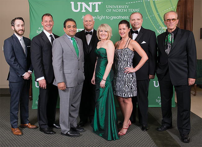 Honored at the Alumni Awards Dinner were, from left, Graham Douglas ('05), C. Tait Cruse ('89), Joe Guerra ('96), Terry Brewer ('65, '70 Ph.D.), Melisa Denis ('86, '86 M.S.), Gabriella Draney ('02), Ernest W. Kuehne Jr. ('66) and Peter Francis Weller ('70). (Photo by Gary Payne)
