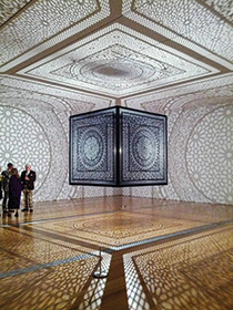 "Agha's piece ""Intersections,"" a black lacquer laser-cut wood cube with a light source, which won the Public Grand Prize and shared the Juried Grand Prize at ArtPrize 2014. (Photo by Terry Gates)"