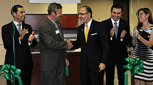 From left, Dallas ISD Board President Miguel Solís, UNT Provost Warren Burggren, Consul General of Mexico Jose Octavio Tripp and MITO Financial representatives celebrate the Ventanilla de Educación ribbon cutting at the Mexican Consular offices this fall. (Photo by Trisha Spence)