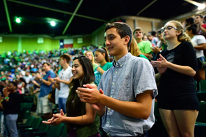 A group of incoming students listen to President Neal Smatresk during the new student convocation. (Photo by Michael Clements)