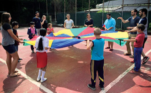 College of Education students participating in outdoor games and activities with children from the Ruth School in Bucharest, Romania, this summer.