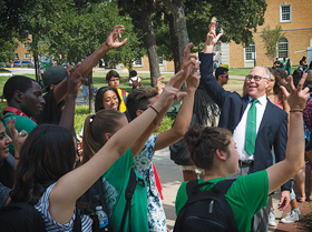 President Neal Smatresk shares his Mean Green pride and greets students with the Eagle Claw on the first day of fall classes. (Photo by Michael Clements)
