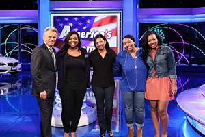 Camille Hall ('08, '10 M.A.) with Pat Sajak (Photo by Carol Kaelson Photographer)