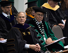 President Neal Smatresk sits with Texas Gov. Greg Abbott, who spoke at May's new University-wide Commencement ceremony. (Photo by Michael Clements)
