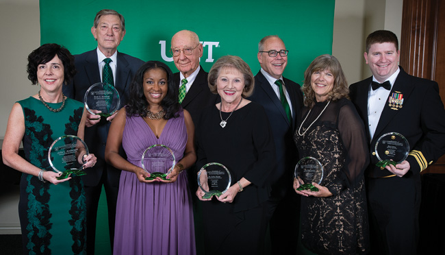 Pictured with President Neal Smatresk, third from right, at the Distinguished Alumni Achievement Awards Dinner are, from left, Julie Anderson ('91, '91 M.S.), Bob Kimmel ('61), Tiffaney Dale Hunter ('01), Leroy Whitaker ('50, '52 M.S.), Cathy Bryce ('91), Barbara Crosby Polansky ('77) of the Hoke family and Kyle Miller, son of Mark Miller ('70, '80). (Photo by Ahna Hubnik)