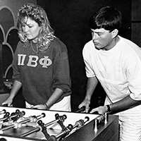 1987 Aerie - students playing foosball