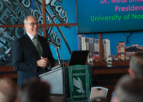President Neal Smatresk talks about UNT's New College at Frisco to open this spring with members of the Frisco Rotary Club in November. (Photo by Ahna Hubnnik)